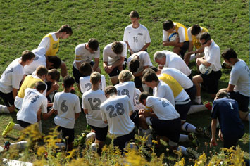 Soccer team praying before game